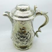 A Victorian silver plated embossed tankard, 21cm