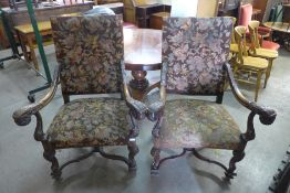 A pair of French carved carved walnut and upholstered fauteuils