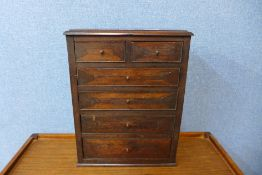 A Victorian pine and mahogany table top chest of drawers, 41cms h x 31cms w