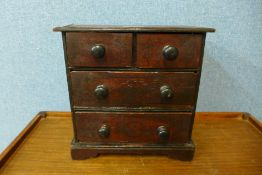 A Victorian apprentices stained pine chest of drawers, 29cms h x 29cms w