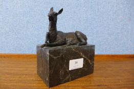 A small bronze figure of a horse, on black marble socle