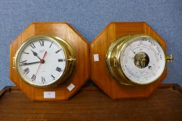 A Schatz marine aneroid barometer and matching wall clock, mounted on oak octagonal plinths