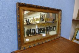 A gilt framed mirror, bearing Kirker Greer & Co., Old Irish Whiskey inscription