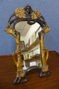 An Art Nouveau style gilt framed dressing table strut mirror