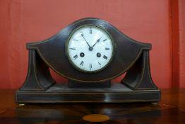 A French Art Nouveau inlaid mahogany timepiece