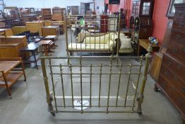 A Victorian brass double bed