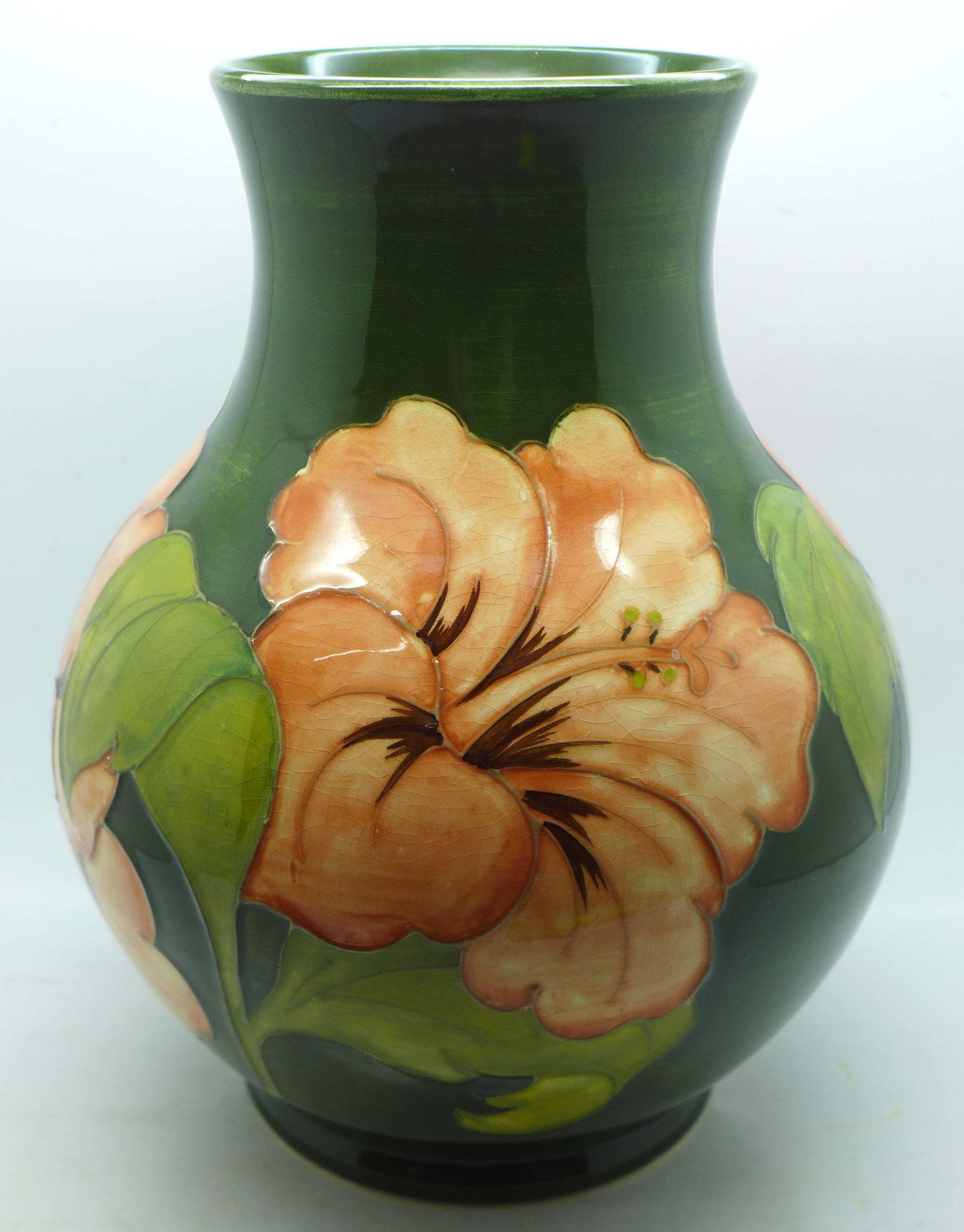 A Moorcroft hibiscus vase, signed and with 1972 Centenary mark to the base, 23cm - Image 3 of 8
