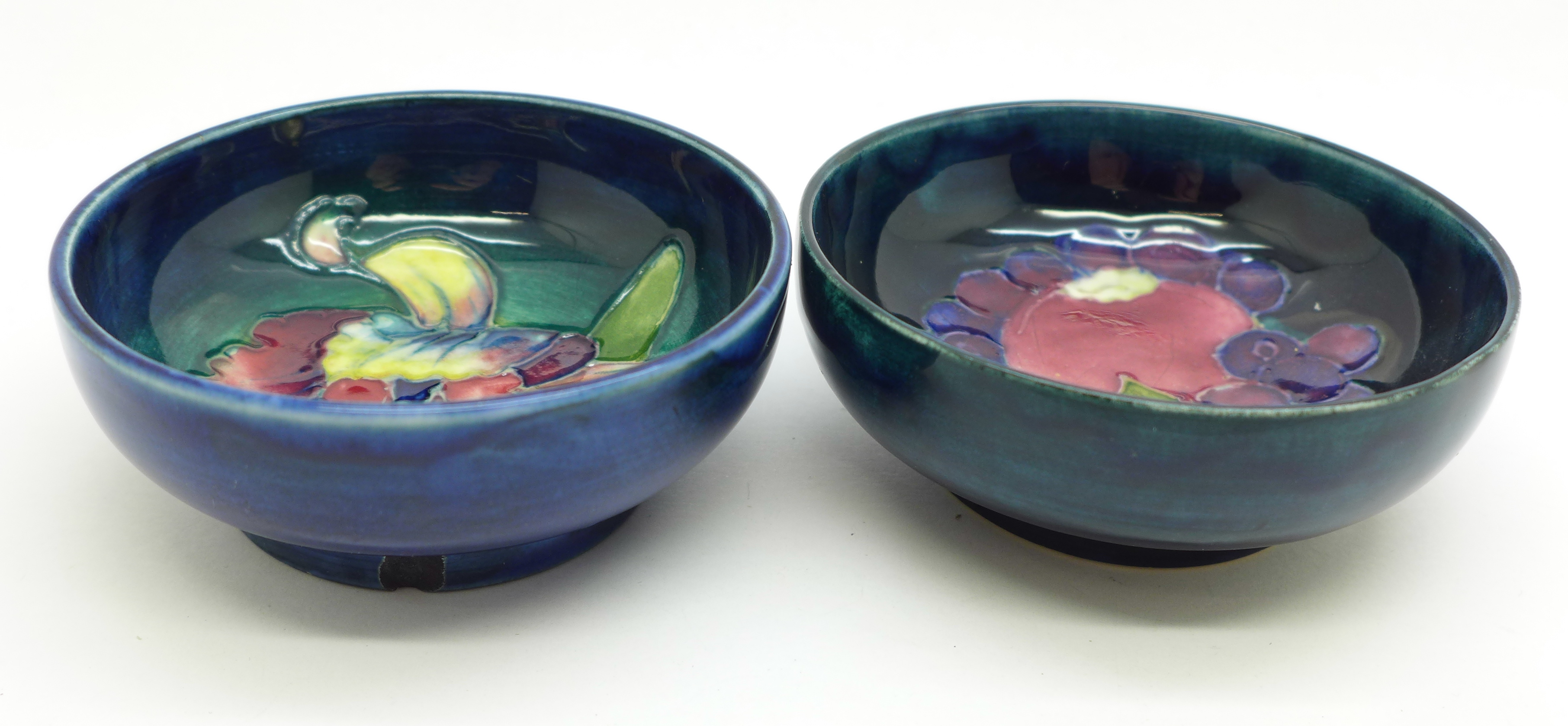 Two Moorcroft dishes, orchid pattern a/f, chip on the side of the base, 72mm, (156,160)