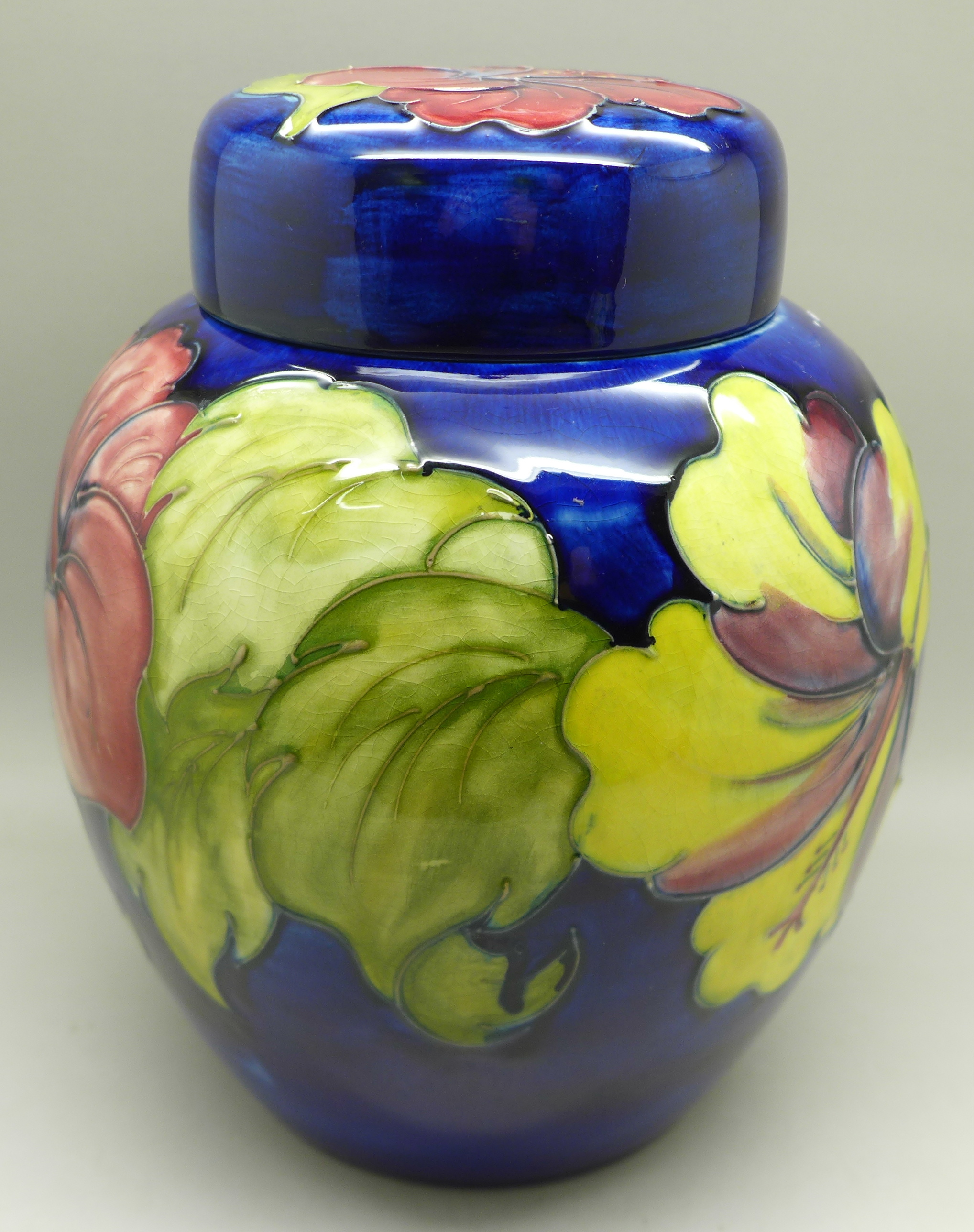 A Moorcroft hibiscus ginger jar on blue ground, signed, with paper label inside lid, 20cm - Image 2 of 9