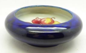 A Moorcroft bowl, with paper label, By Appointment to H.M. The Queen, 11cm diameter