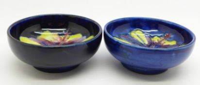 Two small Moorcroft bowls, 8cm diameter, one with crescent shaped crack on the rim, (157,164)
