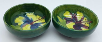 Two small Moorcroft hibiscus bowls, both with 1965 Montreal back-stamps, 8cm diameter