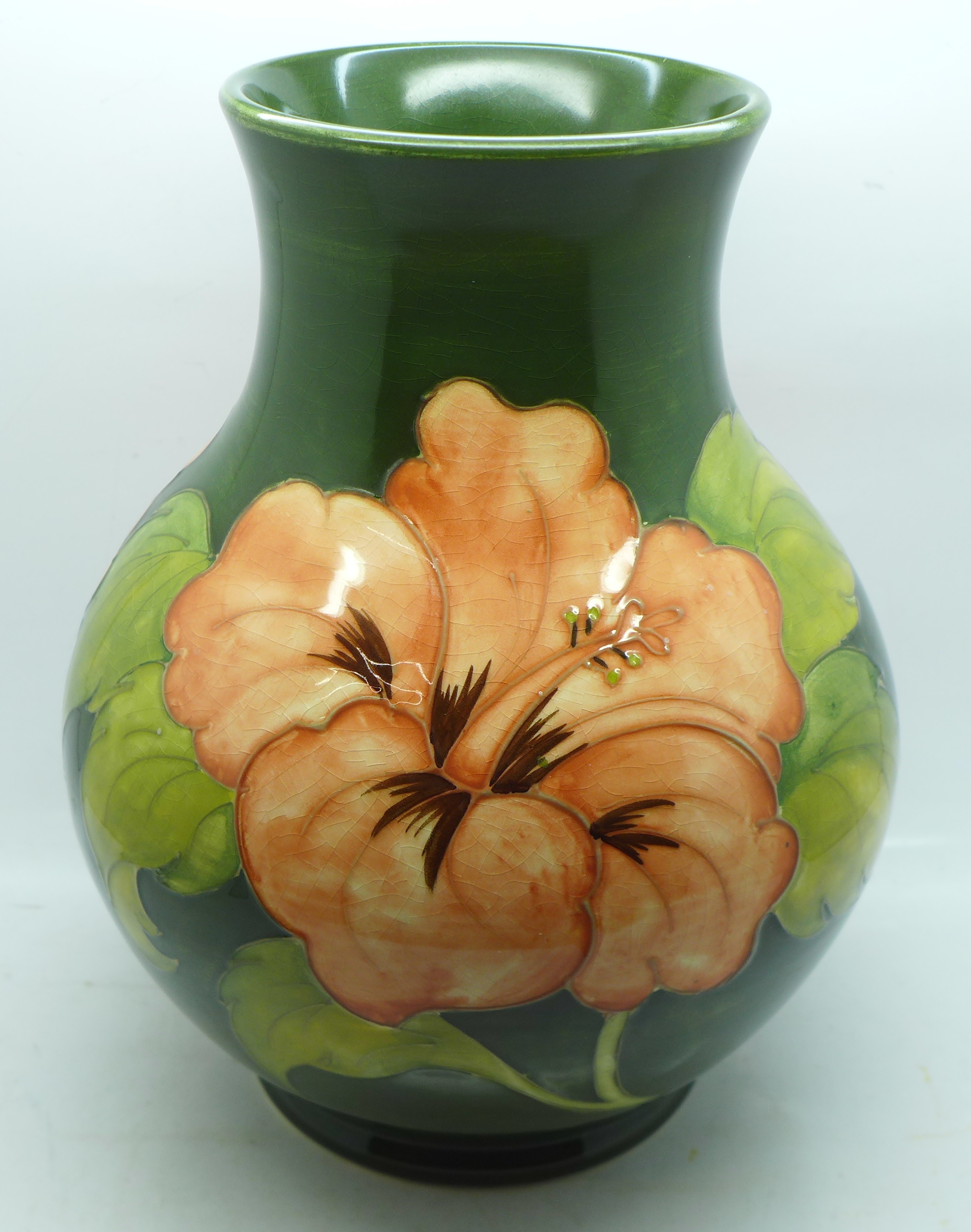 A Moorcroft hibiscus vase, signed and with 1972 Centenary mark to the base, 23cm