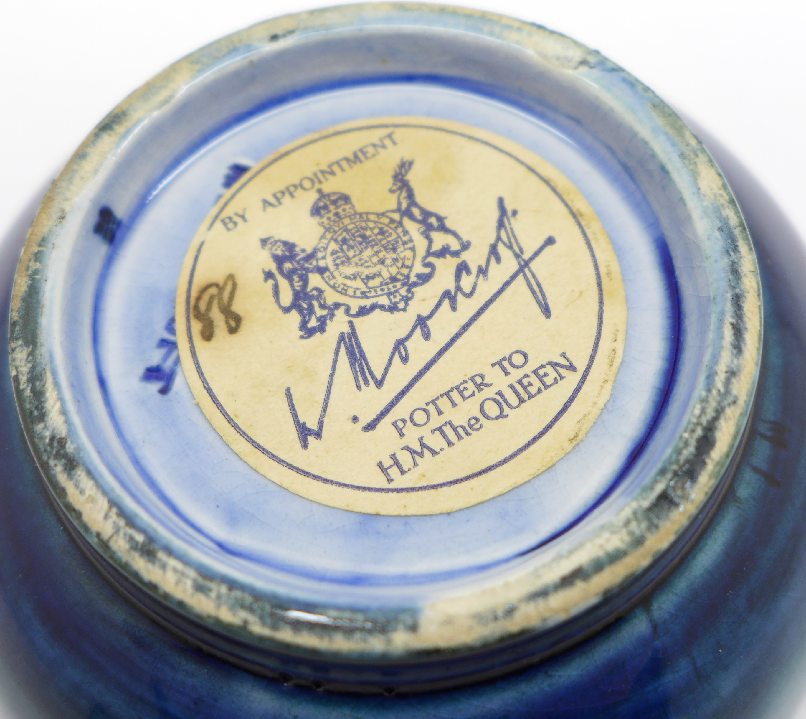 A small Moorcroft pansy bowl, with paper label, By Appointment to H.M. The Queen, 78mm diameter - Image 6 of 6