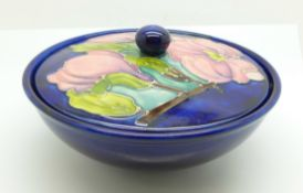 A Moorcroft magnolia lidded bowl, 15.5cm diameter