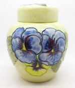 A Moorcroft pansy ginger jar, with red paper label, label a/f, 14cm