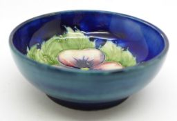 A small Moorcroft pansy bowl, with paper label, By Appointment to H.M. The Queen, 78mm diameter