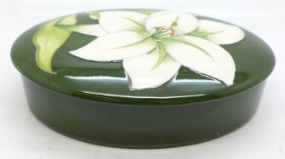 A Moorcroft lidded dish, with paper label, The Late Queen Mary, 126mm diameter
