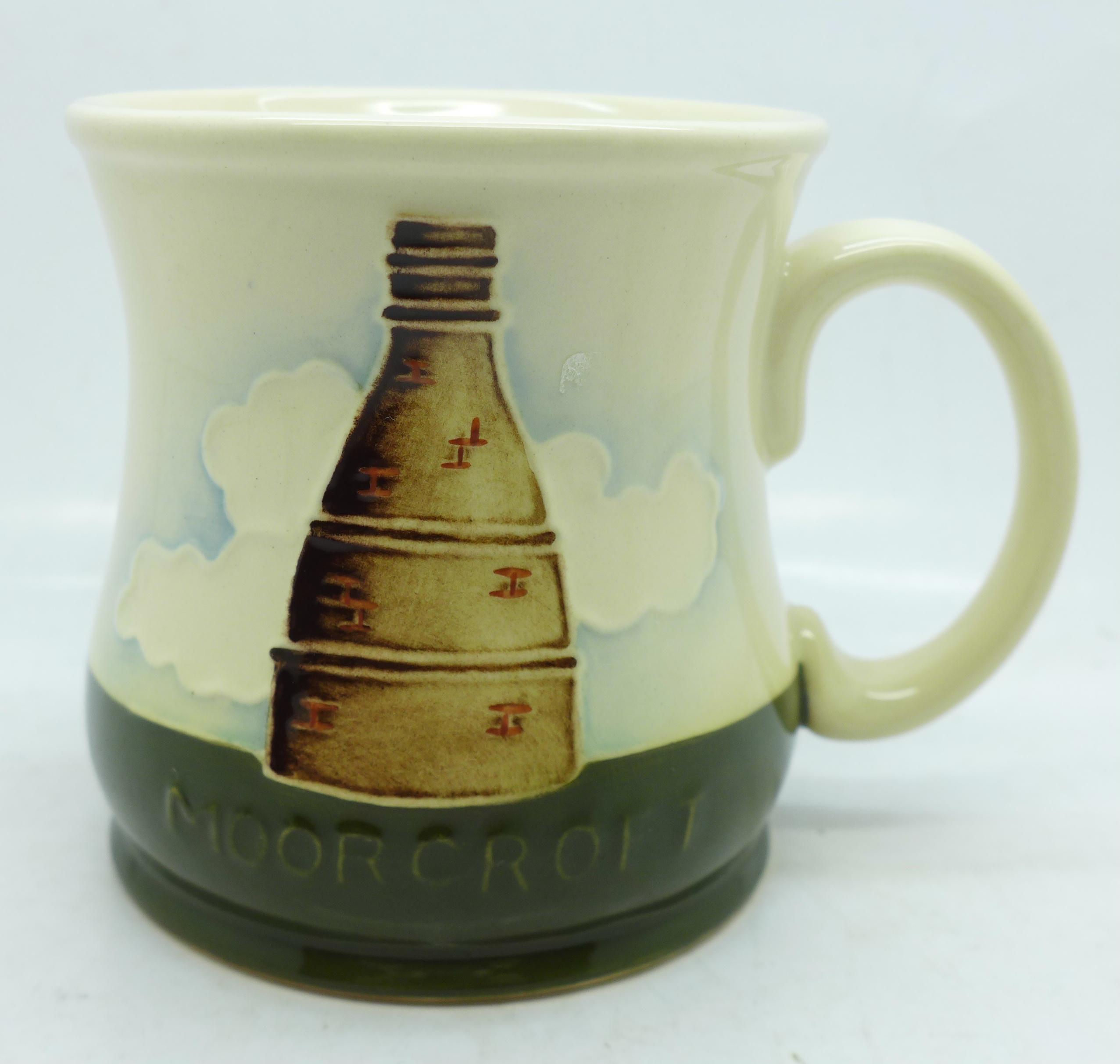 A Moorcroft mug, 1986
