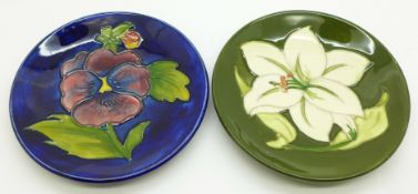 Two Moorcroft dishes, pansy and Bermuda lily, 116mm diameter, (172, 173)