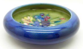 A Moorcroft spring flowers dish, 108mm diameter