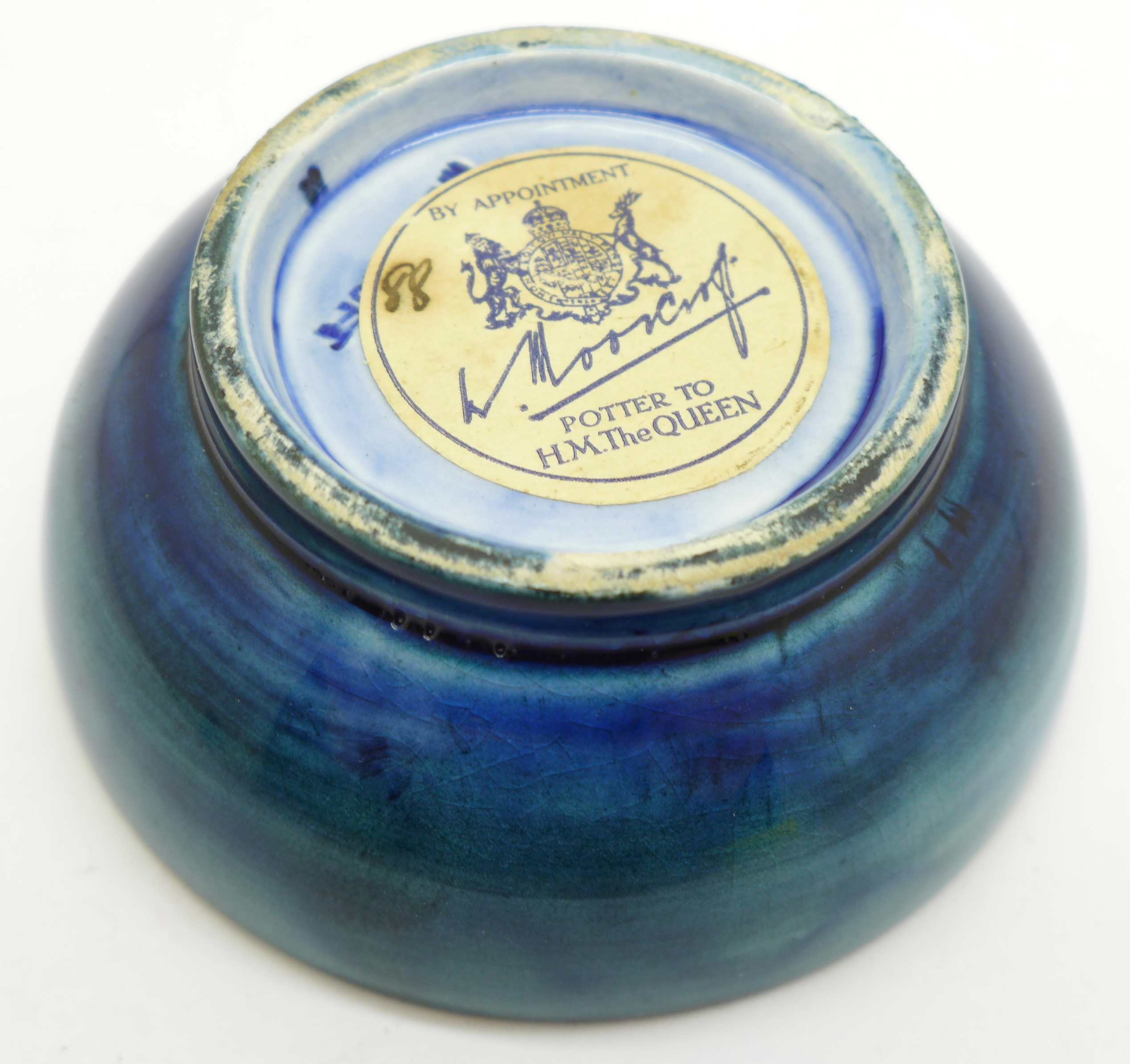 A small Moorcroft pansy bowl, with paper label, By Appointment to H.M. The Queen, 78mm diameter - Image 5 of 6