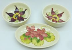 Two Moorcroft bowls and an oval dish, dish 114mm, (167,170,207)
