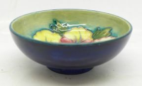 A small Moorcroft hibiscus bowl, with paper label, The Late Queen Mary, 9cm