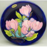A Moorcroft magnolia plate, 25cm