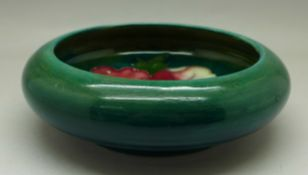 A Moorcroft hibiscus bowl, 128mm diameter, possibly restored