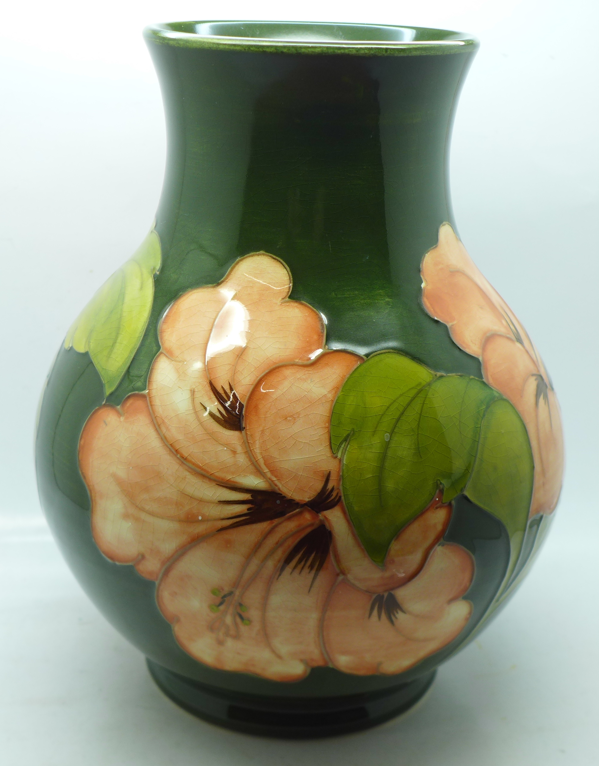 A Moorcroft hibiscus vase, signed and with 1972 Centenary mark to the base, 23cm - Image 4 of 8