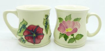 Two Moorcroft mugs, one marked The Ransley Collection, 1996 Collectors Club, (39,40)