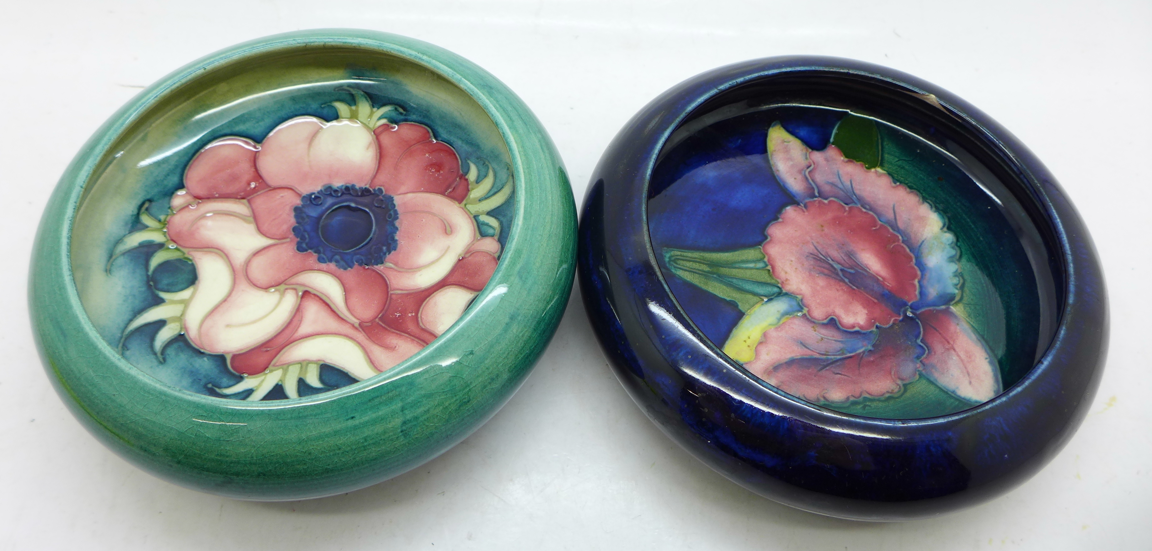 Two Moorcroft dishes, orchid a/f, chip under the rim, and anemone, 11cm, (14,125)