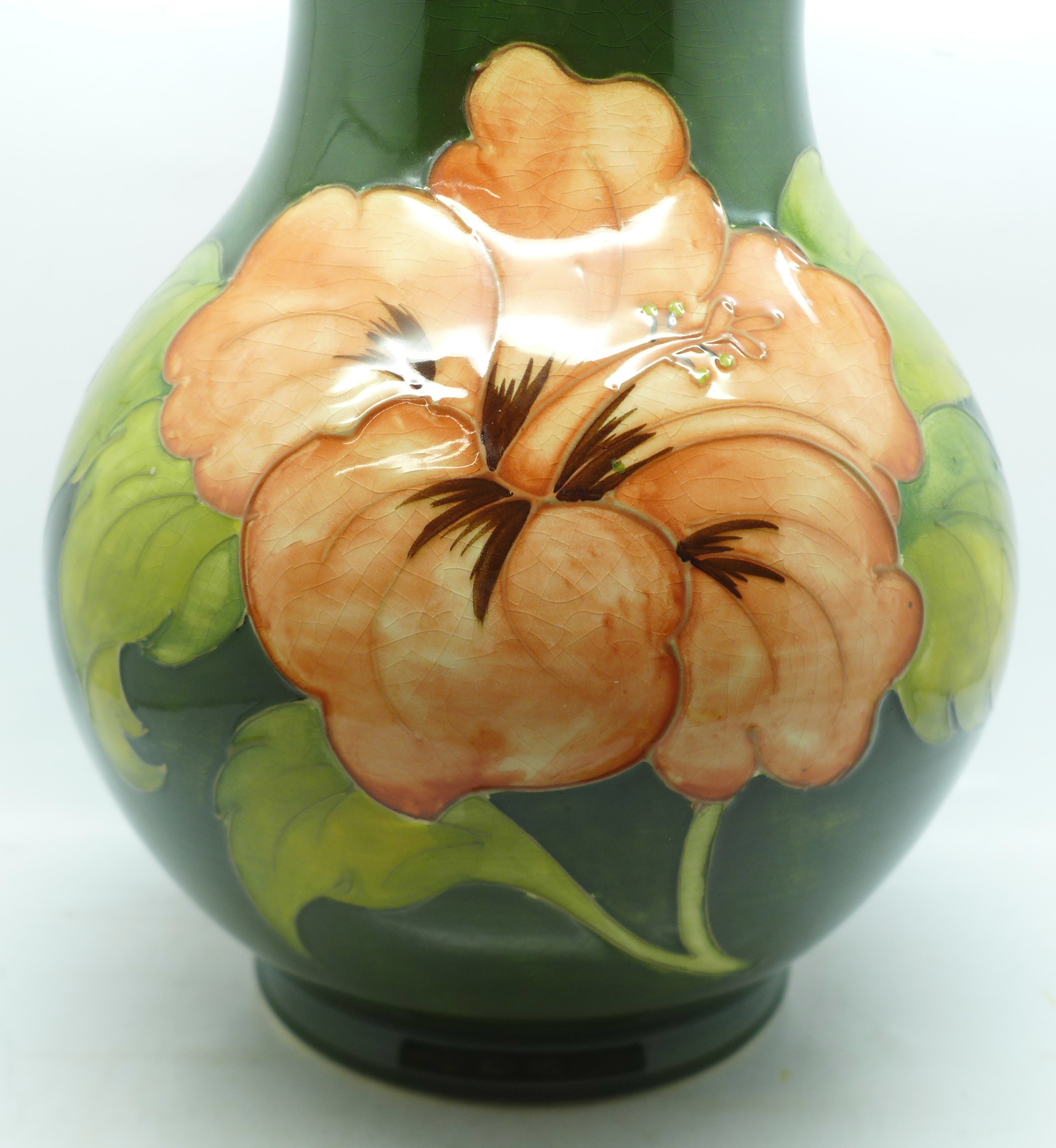 A Moorcroft hibiscus vase, signed and with 1972 Centenary mark to the base, 23cm - Image 2 of 8