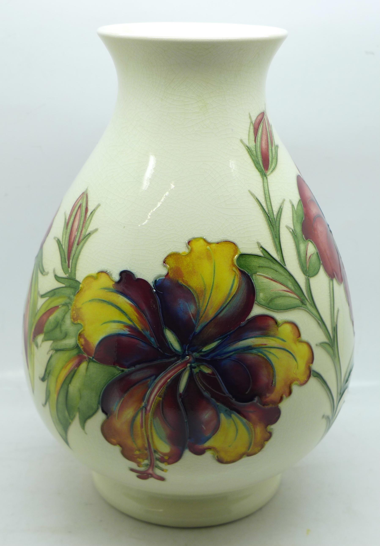 A Moorcroft hibiscus vase, crazed, 20.5cm
