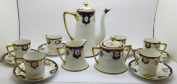 A Kokura Japanese six setting coffee set with cream and sugar, three coffee cans a/f