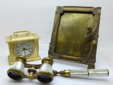A pair of French brass and mother of pearl opera glasses with handle, marked Monte-Carlo Aix-Les-