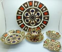 A Royal Crown Derby 1128 dinner plate, cup and saucer, two pin trays and a small dish