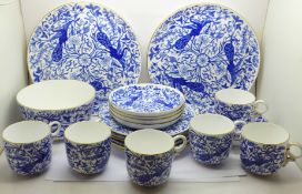 A Derby porcelain six setting tea set with two cake plates and sugar bowl, plates with impressed