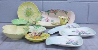 Eight Carlton Ware dishes and a jug and a Clarice Cliff shallow dish, (fault/chip on the Clarice