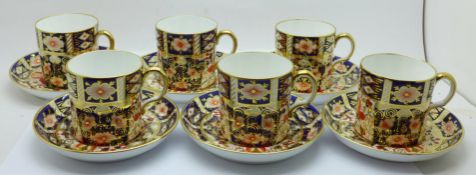 A set of six Royal Crown Derby 2451 coffee cans and saucers