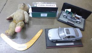 A vintage Teddy bear, a/f, a boomerang and three model vehicles, Franklin Mint 1907 Rolls Royce,