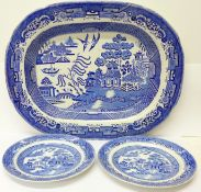 A Willow pattern meat plate and two similar circular plates