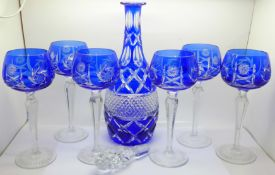 A blue flash cut crystal decanter and six hock glasses