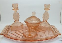 A peach glass dressing table set, tray chipped