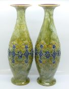 A pair of Royal Doulton saltglaze relief moulded vases, 27cm