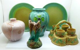 A Majolica triple fish vase, a/f, Majolica egg cups and stand, two Royal Doulton plates with green