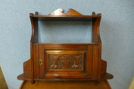An Edward VII carved walnut wall hanging cabinet, 59cms h x 70cms w