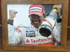 Formula 1; a framed and signed photograph, Lewis Hamilton, frame 24 x 29cm