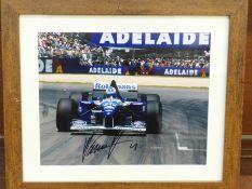 Formula 1; a framed and signed photograph, Damon Hill, frame 29.5 x 34.5cm